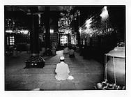 Prayer in ornate papier-mache walled Shah Hamden Mosque, Indian Administered Kashmir..