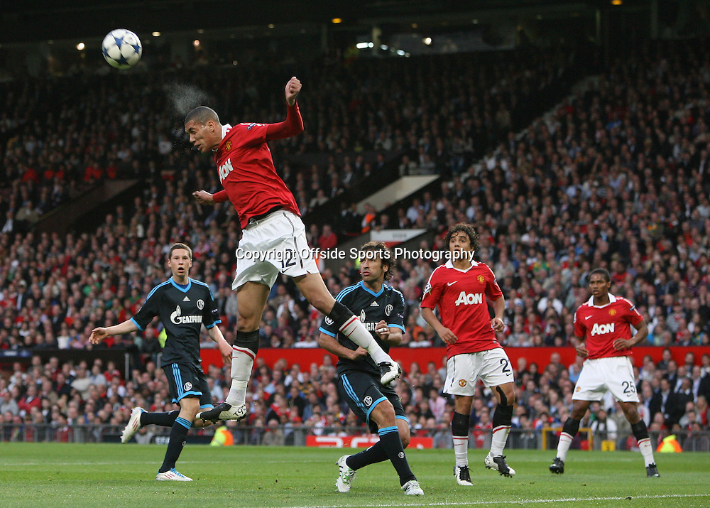 04/05/2011 - UEFA Champions League - Semi-Final (2nd Leg) - Manchester United vs. Schalke 04 - Chris Smalling of Man Utd clears with a header as spray comes off his head - Photo: Simon Stacpoole / Offside.