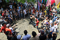 A mock Silat fight on the beach at the Maulid Nabi festival, Cikoang, Sulawesi, Indonesia.