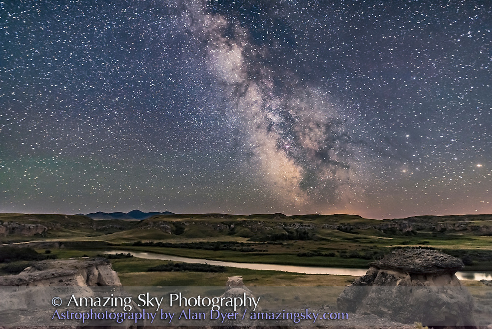 The summer Milky Way and galactic centre area to the south over the Milk River in Alberta and the Sweetgrass Hills of Montana, from the viewpoint road at Writing-on-Stone Provincial Park, Alberta, on New Moon night, August 1, 2016. Sagittarius and the Dark Horse of dust lanes in Ophiuchus and Serpens is above the southern horizon, as are the star clusters M6 and M7 in Scorpius. Mars and Saturn are at right, with Saturn above Antares. <br /> <br /> This is a stack of 10 images, average mean combined, for the ground to smooth noise, and a single untracked exposure for the sky. All are 30 seconds at f/2 with the 20mm Sigma Art lens and Nikon D750 at ISO 4000. These frames were from the beginning of a motion control panning sequence for a time-lapse movie, with the Syrp Genie Mini, but in the initial frames before the Genie began to move.