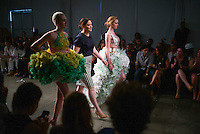 Sept. 11, 2013 - New York, NY - Designer Jennifer Henry with her collection of outfits made out of  Subway sandwich accessories for the Project Subway fashion show at Chelsea Piers.<br /> (Photo by Robert Caplin)