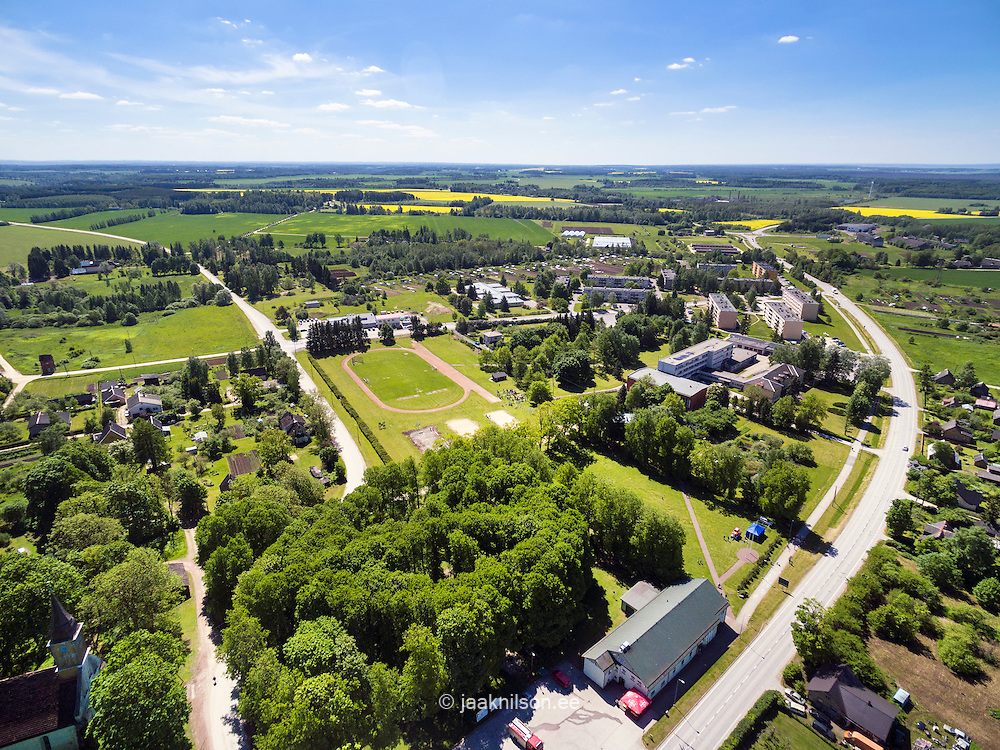 Puhja village, settlement. Aerial view, landscape, roadside buildings in Estonia.