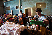 Two women collect clothing from piles of donations at a humanitarian center set up in the village of Naselje Dobor in Modrica, Bosnia and Herzegovina. <br /> <br /> Photo by Matt Lutton / Boreal Collective<br /> <br /> Flooding in Bosnia and Herzegovina.