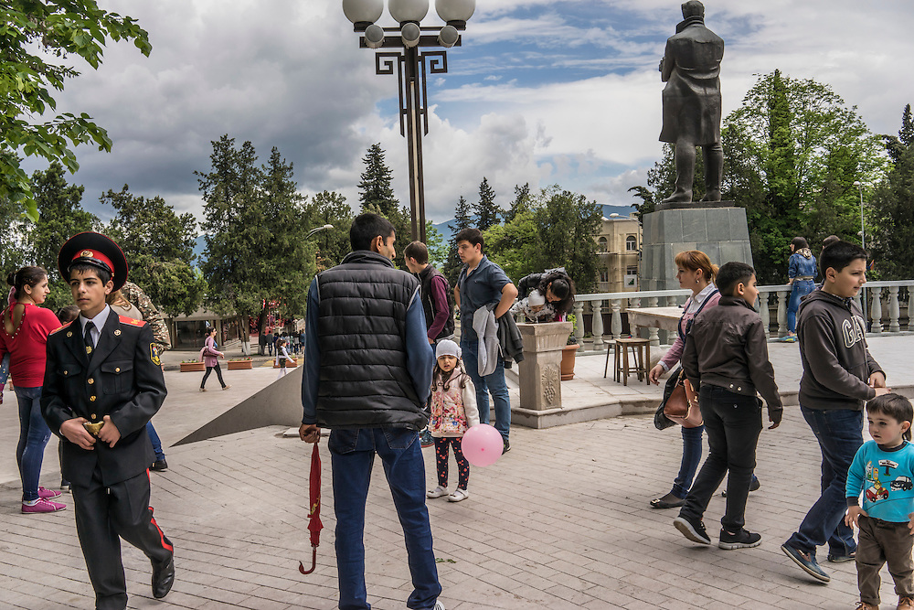 People gather in a local park to enjoy the warm weather following a ceremony commemorating both the victory over Nazi Germany in the Second World War as well as the fall of the strategic town of Shushi to Armenian forces on Monday, May 9, 2016 in Stepanakert, Nagorno-Karabakh.