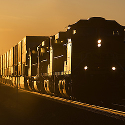 Minutes after the sun peaked over the Tehachapi Mountains in southern California, this westbound BNSF intermodal train topped the grade and coasted into town, catching the first rays of the warm early morning sun.