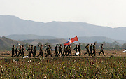 North Koreans soldiers march along the Sino-North Korean border near Dandong on Friday 13 October 2006. US Secretary of State Condoleezza Rice warned that additional sanctions may be needed if North Korea conducts a second nuclear test, she told reporters in Tokyo Thursday 18 October 2006.
