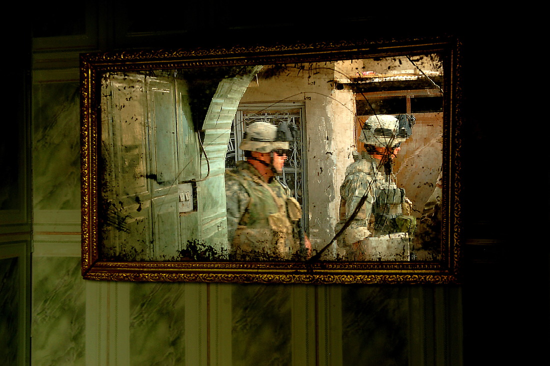 Soldiers from Bravo Company, 2-6 Infantry, Task Force 1-35 Armored Division, Baumholder, Germany, leave an Iraqi family's home on August 7, 2006 after questioning them and filling out a census in Tameem, Ramadi, Iraq. The census is geared to finding out general information on the Iraqi household and to see if they have any concerns or questions they can help with. — © TSgt Jeremy Lock/