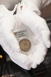 London, March13th 2015. Ahead of the first sale of the D. Brent Pogue rare United States Federal coin  collection sale to be held at Sotheby's  New York. The collection is composed of over 650 gold, silver, and copper coins, and is expected to be the most valuable collection of coins ever sold. PICTURED: The finest known example of a 1794 Silver Dollar, the first intended for circulation, which is expected to fetch up to $10 million at auction.