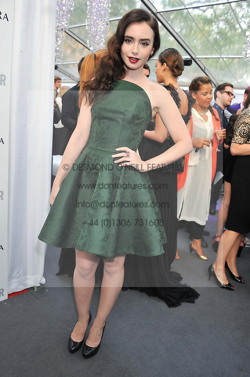 LILY COLLINS at the Glamour Women of the Year Awards 2012 in association with Pandora held in Berkeley Square Gardens, London W1 on 29th May 2012.