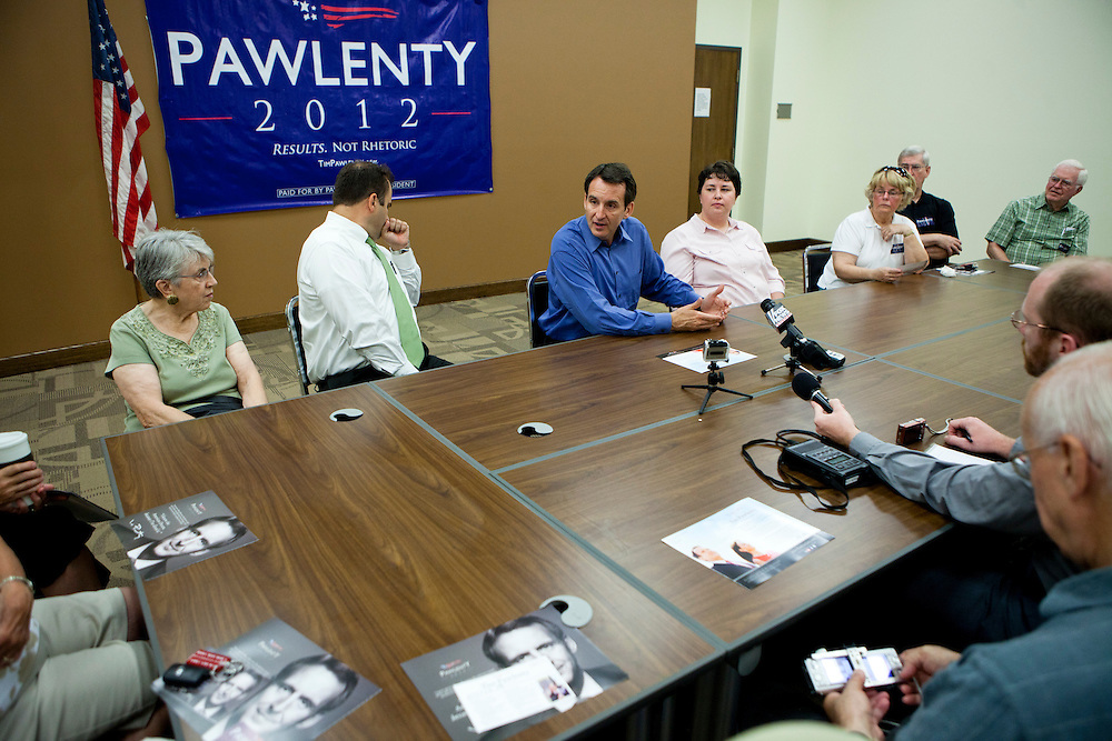 Republican presidential hopeful Tim Pawlenty, third from left, campaigns on Tuesday, July 26, 2011 in Washington, IA.