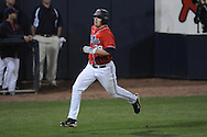 Ole Miss' Taylor Hightower (13) hits a three-run double, scoring Ole Miss' Matt Tracy (29) at Oxford-University Stadium in Oxford, Miss. on Wednesday, March 2, 2010.
