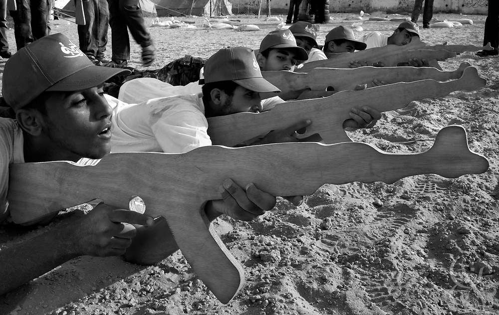 "Palestinian ""Marytr Campers"" practice taking aim with wood block ak-47 replicas during training August 01, 2007 at a HAMAS sponsored summer camp in Gaza City, Gaza. The summer camps provide valueable indoctrination of new membership for HAMAS and help shore up popular community support by providing the free camps to nearly 100,000 kids across the Gaza strip."