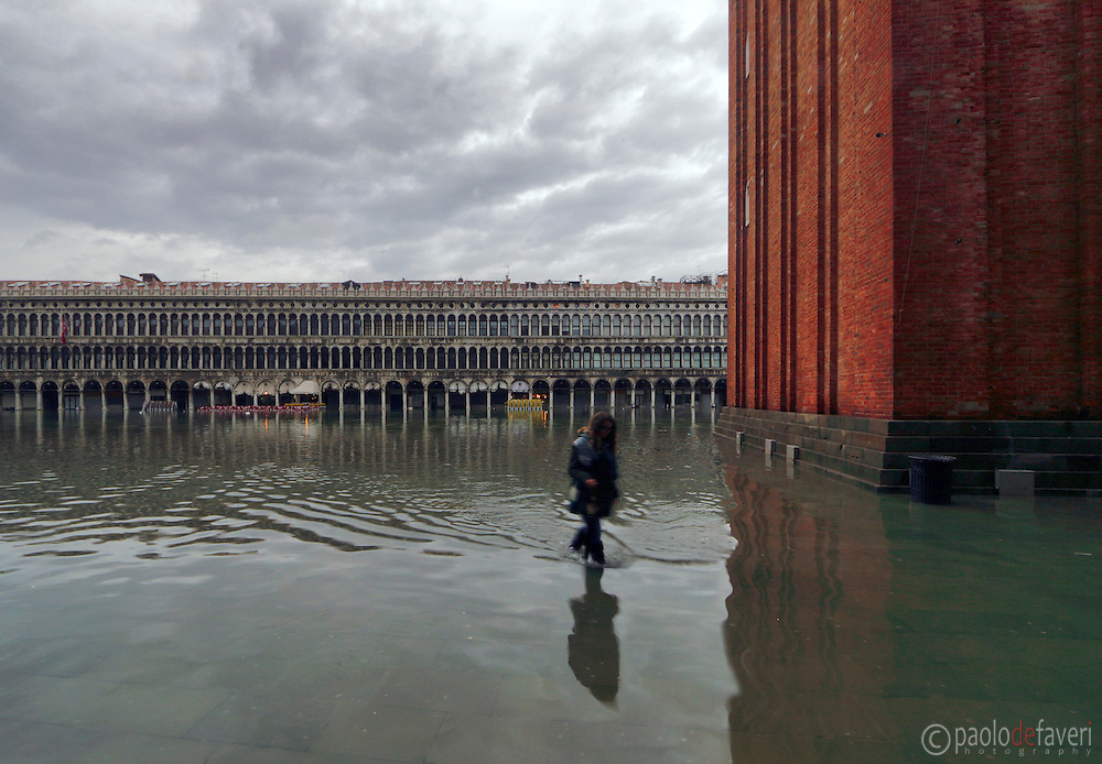 """San Marco square flooded with about 30 cms (1 foot) of water. Taken on an early morning at the end of January when the rising tide had already completely flooded the city, producing that phenomenon known as """"acqua alta""""."""