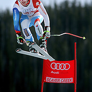 SHOT 12/1/11 12:39:06 PM - Swiss skiier Ambrosi Hoffman launches himself off the Red Tail jump during men's downhill training on the Birds of Prey course at the Audi FIS World Cup on December 1, 2011 in Beaver Creek, Co. (Photo by Marc Piscotty / © 2011)