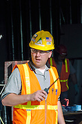 Anchorage airport Concourse C Construction worker with radio