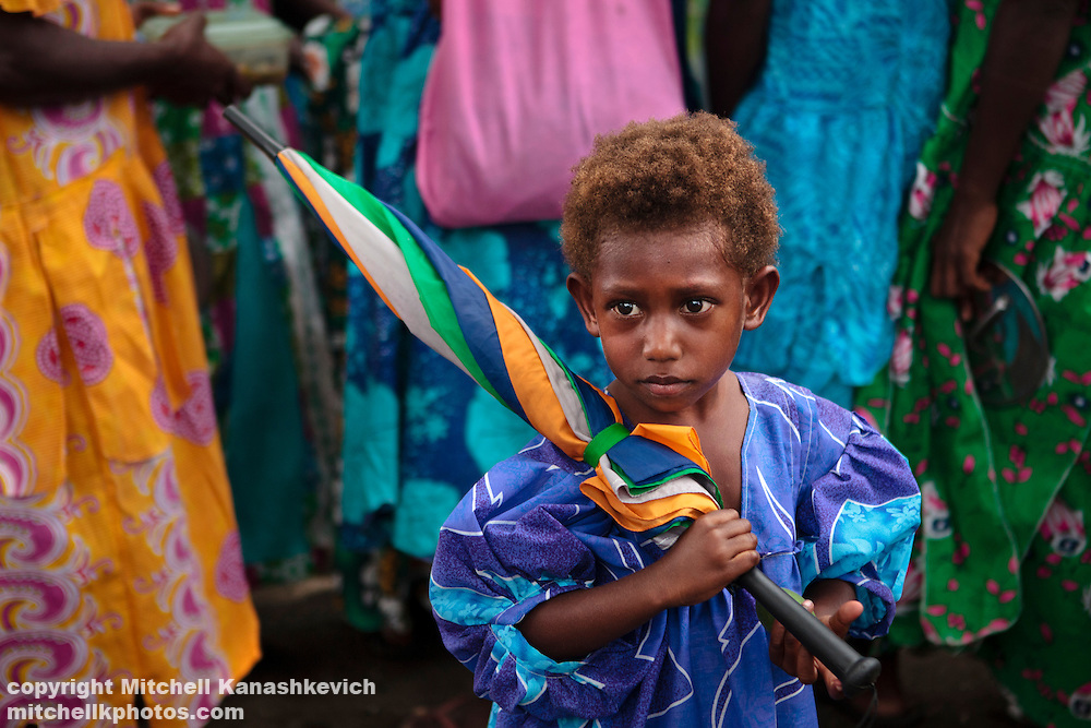 Ni Vanuat girl in a church dress with an umbrella. Uleveo, Maskelyne Island, Malampa Province, Malekula, Vanuatu