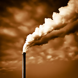 Dramatic view of an industrial chemin with exhalations of steam