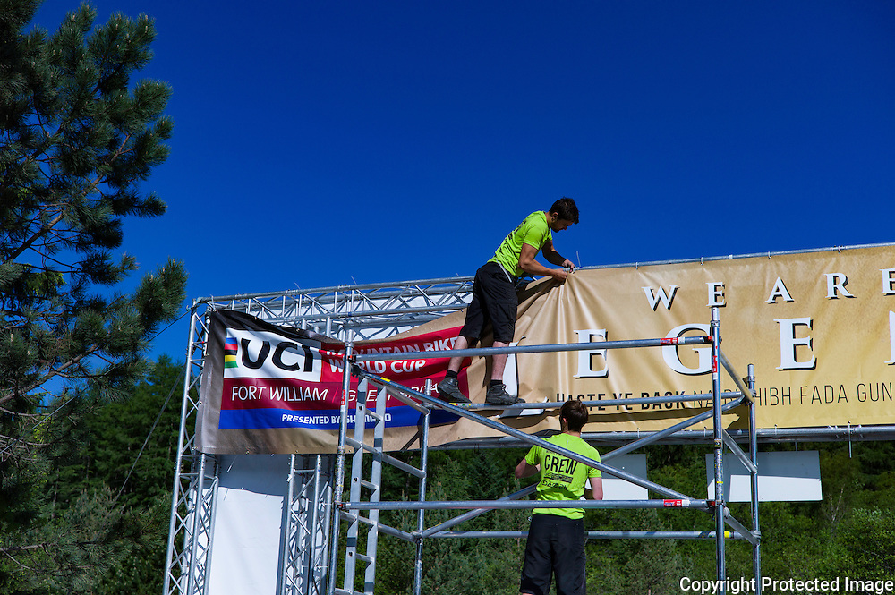 Nevis Range, Fort William, Scotland, UK. 3rd June 2016. Support crew put the finishing touches to a banner at the UCI Mountain Bike World Cup which takes place on Nevis Range in the Scottish Highlands this weekend.