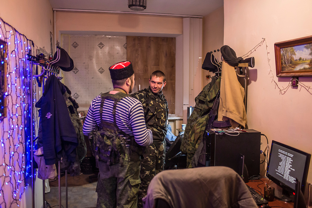 PERVOMAISK, UKRAINE - NOVEMBER 20, 2014: Petr Khokhlov, right, a member of the First Cossack Regiment Named Platov of the Great Don Army, talks with Ruslan Alyfyrenko, another member of the regiment, in the dormitory where they are stationed in Pervomaisk, Ukraine. CREDIT: Brendan Hoffman for The New York Times