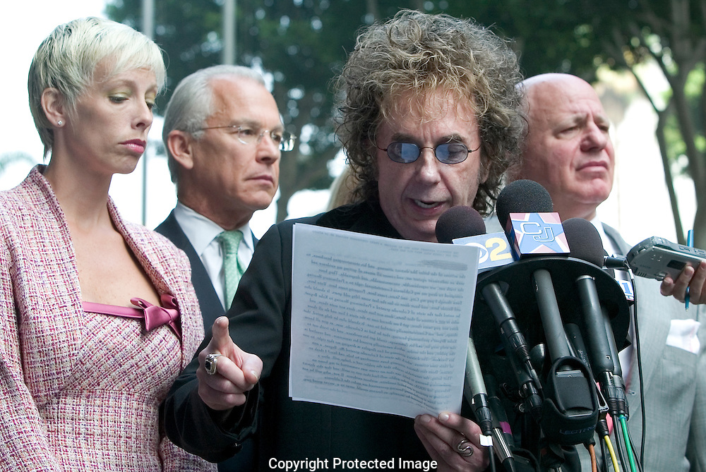 "Record Producer Phil Spector Indicted For Murder of movie actress and House of Blues hostess Lana Clarkson...Spector read a prepared statement professing his innocence of Clarkson's death...Spector, who was arrested soon after the shooting, claimed in an interview with Esquire magazine that Clarkson ""kissed the gun'' and killed herself. ..The 1989 Rock and Roll Hall of Fame inductee is best known for his layered ""Wall of Sound'' recording technique. He has worked with the Crystals, the Ronettes, the Ramones, Gene Pitney, the Righteous Brothers, Bruce Springsteen and the Beatles. ..He is free on 1 million dollar bond...9/27/04.Criminal Courts Bldg. Downtown, LA, CA USA"