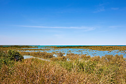 View from the foreshore over the vibrant aqua water of Roebuck Bay.