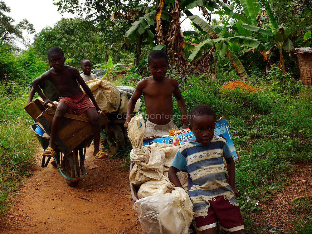 Boys play on wheelbarrow, Kingsville #7, Liberia.