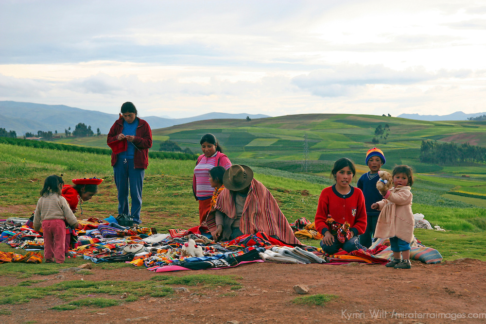 Americas, South America, Peru.  Peruvians sell their handmade goods along the roadside of the Urubamba Valley.