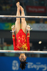 China's Jiang Yuyuan competes on the uneven bars during the artistic gymnastics women's qualifications in the National Indoor Stadium during the Olympic games in Beijing, China, 10 August 2008.