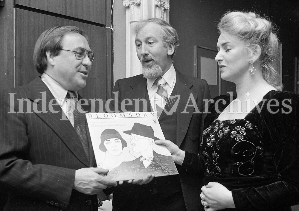 Teresa O'Driscoll who along with Joe Heaney record the Bloomsday Tribute to James Joyce, presenting a copy to the Canadian Ambassador Mr Alan Sullivan at the launching in the Arts Club in Fitzwilliam Square, also pictured is Prof Robert O'Driscoll Teresa's husband, 16/06/1982 (Part of the Independent Newspapers Ireland/NLI Collection).