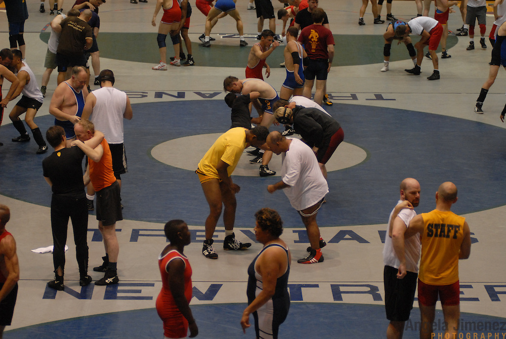 Gay and lesbian wrestlers participate in a wrestling clinic taught by Northwestern University's head men's wrestling coach Tim Cysewski at McGaw Memorial Hall/Welsh-Ryan Arena in Evanston, Illinois during the Gay Games VII competition on July 16, 2006.<br /> <br /> Over 12,000 gay and lesbian athletes from 60 countries are in Chicago competing in 30 sports during the Games from July 15 through 22, 2006. <br /> <br /> Over 50,000 athletes have competed in the quadrennial Games since they were founded by Dr. Tom Wadell, a 1968 Olympic decathlete, and a group of friends in San Francisco in 1982, with the goal of using athletics to promote community building and social change. <br /> <br /> The Gay Games resemble the Olympics in structure, but the spirit is one of inclusion, rather than exclusivity. There are no qualifying events or minimum or maximum requirements.<br /> <br /> The Games have been held in Vancouver (1990), New York (1994), Amsterdam (1998), and Sydney (2002).