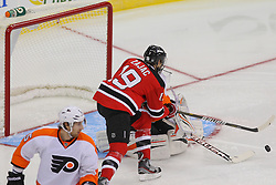 Jan 22, 2013; Newark, NJ, USA; New Jersey Devils center Travis Zajac (19) scores a goal on Philadelphia Flyers goalie Ilya Bryzgalov (30) during the first period at the Prudential Center.