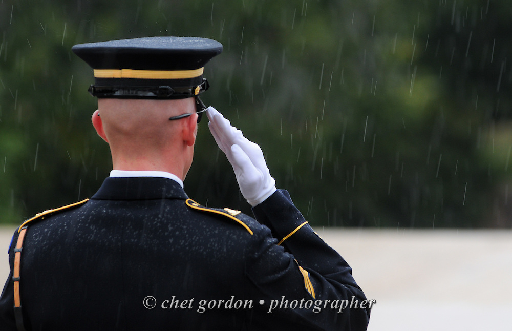 "A sentry with the United States Army's 3rd Infantry Regiment Honor Guard or ""Old Guard"" salutes during a wreath laying ceremony at the Tomb of he Unknowns at Arlington National Cemetery in Arlington, VA on Saturday, September 21, 2013."