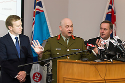 Defence Minister Jonathan Coleman, left, Chief of Defence Staff, Lieutenant General Rhys Jones and Prime Minister John Key at a media conference following the death of two Kiwi Soldiers and several casualties from the Provincial Reconstruction Team in an incident north-east of Bamiyan Province, Afghanistan, Whenuapai Airbase, Auckland, New Zealand, Sunday, August 05, 2012.  Credit:SNPA / David Rowland