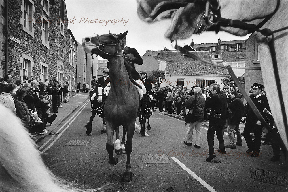 Three women attempt to join common riding in Hawick, Scottish borders.