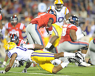 Ole Miss' Nickolas Brassell (2) is tackled by LSU safety Brandon Taylor (18) at Vaught-Hemingway Stadium in Oxford, Miss. on Saturday, November 19, 2011..