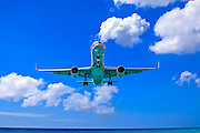 An American Airlines jet on final approach into St. Maarten's Princess Juliana International Airport.
