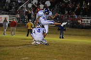 Water Valley's Alex Robles (41) kicks out of the hold of Water Valley's Cole Camp (4) vs. South Pontotoc in Pontotoc, Miss. on Friday, October 7, 2011. Water Valley won 49-7.