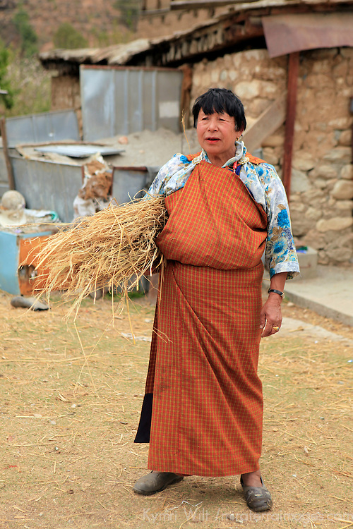 Asia, Bhutan, Paro. A Bhutanese woman tends her farm in Paro Valley.