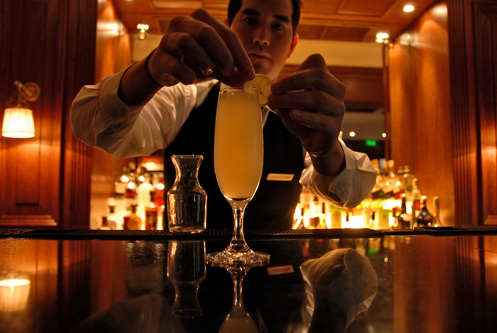 Bartender prepares Pisco Sour drink at the Ritz Carlton Hotel bar in Santiago, Chile