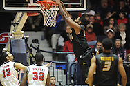 "Ole Miss vs. Missouri's Torren Jones (24) dunks at the C.M. ""Tad"" Smith Coliseum in Oxford, Miss. on Saturday, February 8, 2014. (AP Photo/Oxford Eagle, Bruce Newman)"