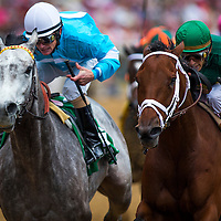 Authenticity with John Velazquez up (right) out duels On Fire Baby and Joe Johnson (left) to win the LA Troienne Stakes at Churchill Downs in Louisville, KY on May 03, 2013. (Alex Evers/ Eclipse Sportswire)