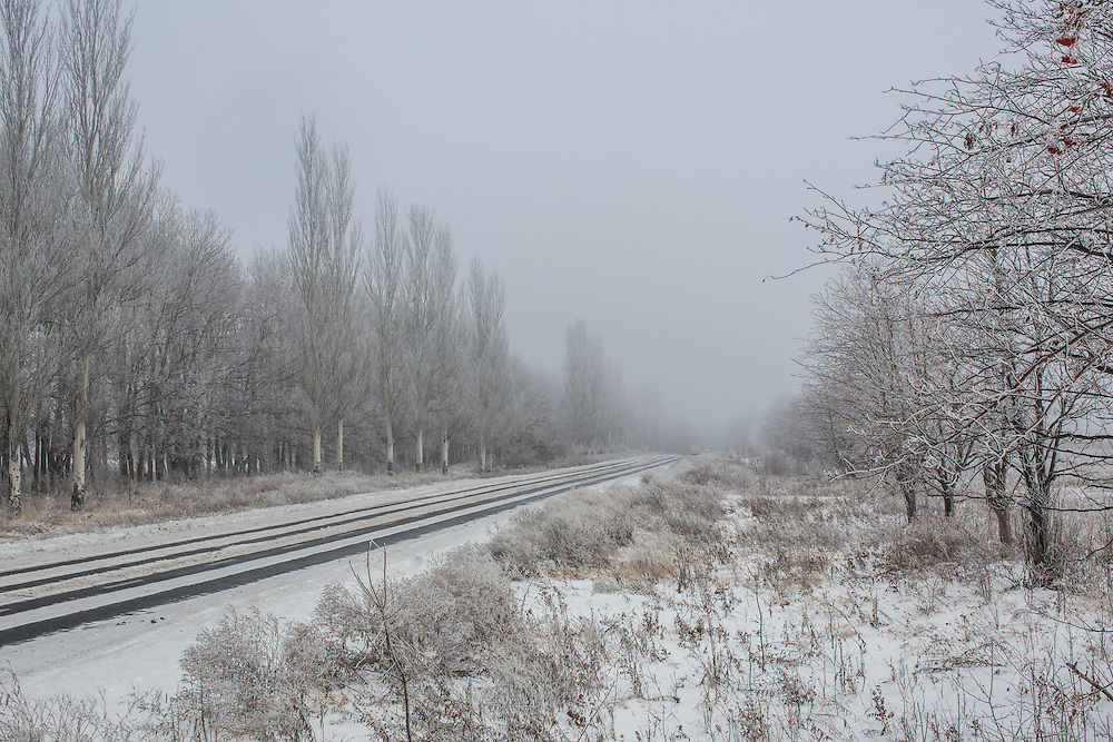 SNIZHNE, UKRAINE - DECEMBER 8, 2014: Snow covers everything along the road between Donetsk and Luhansk in Snizhne, Ukraine. CREDIT: Brendan Hoffman for The New York Times