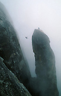 A climber makes the difficult Tyrolean traverse from the summit of Lost Arrow Spire in Yosemite National Park