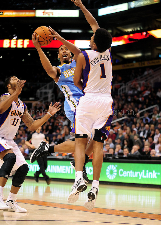 Dec. 22, 2011; Phoenix, AZ, USA; Denver Nuggets point guard Andre Miller (24) puts up a shot against Phoenix Suns shooting guard Josh Childress (1) during the first half of a preseason game at the US Airways Center. Mandatory Credit: Jennifer Stewart-US PRESSWIRE..