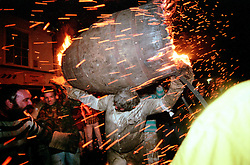 """SPARKS FLY"".THE TAR BARRELS OF OTTER ST MARY EAST DEVON..BY RUPERT RIVETT©2003..07771928201.(01273)695107"