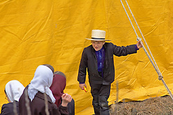 Young amish boy and three girls interact at Lancaster county spring mud sale.