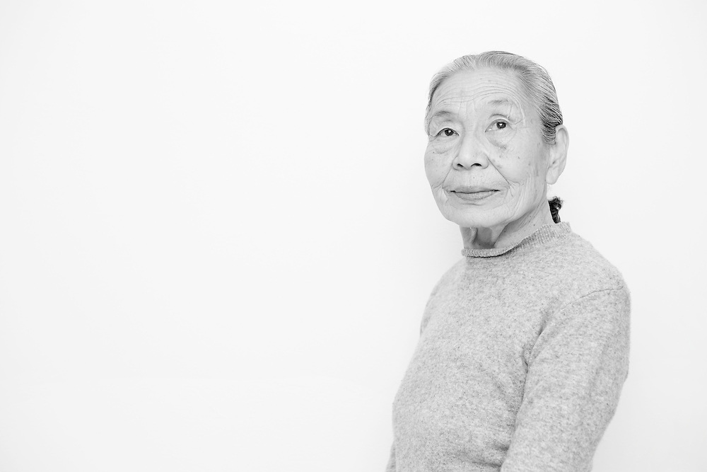 Black and white portrait photograph of old asian woman contemplating and thinking
