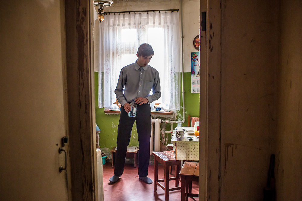 LUHANSK, UKRAINE - MARCH 15, 2015: Pavel Pavlov prepares tea in his mother's apartment in Luhansk, Ukraine. CREDIT: Brendan Hoffman for The New York Times