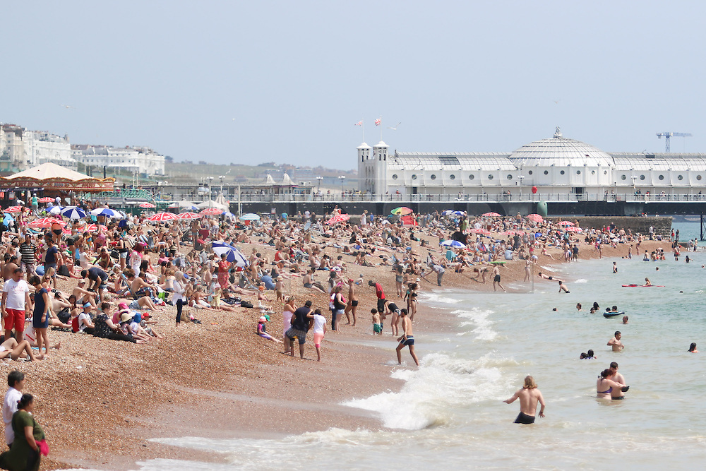 © Licensed to London News Pictures. 03/07/2015. Brighton, UK. Thousands of people relax in the sunshine on Brighton Beach, today July 3rd 2015. Photo credit : Hugo Michiels/LNP