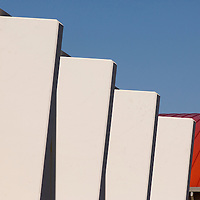 Abstract view of concrete fins and red roof at Sweetwater High School, National City, CA. Built 1920.